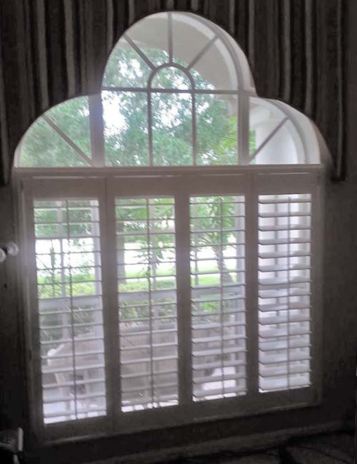 plantation window shutters - wood shutters painted white with adjustable slats
